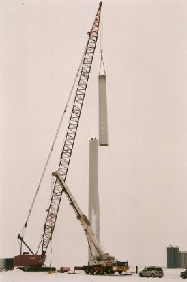 Crane lift of third tower section for 1st Glenmore wind turbine, Jan. 1998